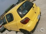 Photo Toyota Yaris 2004 Yellow