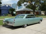 Photo Cadillac deville essence 1964