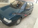 Photo Fiat Uno Essence Mod 1997 à Taza