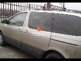 Photo Gold toyota sienna 2002