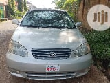 Photo Toyota Corolla 2003 Sedan Automatic Silver