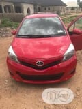 Photo Toyota Yaris 2013 5-Door LE Automatic Red