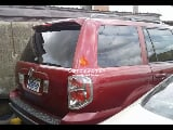 Photo Red honda pilot 2006 at ojodu berger lagos