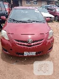 Photo Toyota Yaris 2007 Sedan Red