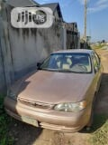 Photo Toyota Corolla 2000 Gold