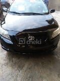 Photo 2010 Black Automatic Toyota Corolla