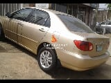 Photo Gold toyota corolla 2003