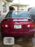 Photo Toyota Corolla 2003 Sedan Red