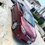 Photo 2012 Maroon Automatic Toyota Corolla