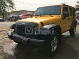 Photo 2015 Yellow Automatic Jeep Wrangler