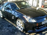 Photo Nissan 350z Black with Gullwing Doors and Bodykit